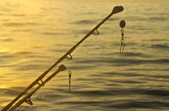 Spinning rods in front of water Stock Photography