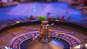 Spinning Roulette wheel and putting bets stock video footage