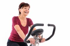 Spinning senior woman. Spinning - smiling senior woman - isolated Stock Photography