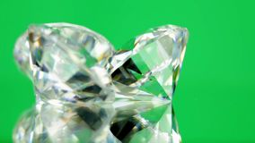 Spinning shining three diamonds stock footage