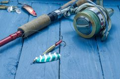 Spinning and spinning reel. Spoon. Fishing bait. Fishing set. Spinning and spinning reel. Spoon. Fishing bait Stock Photos
