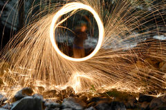 Spinning steel wool on fire. Royalty Free Stock Photo