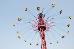 Spinning swing. The spinning swing at fairground Royalty Free Stock Photos
