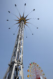 Spinning swing at fairground Stock Photos
