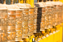 Spinning Tibetan Buddhist prayer wheels at Boudhanath stupa in Kathmandu Royalty Free Stock Photos