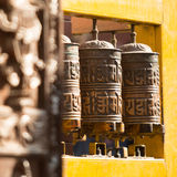 Spinning Tibetan Buddhist prayer wheels in Kathmandu Stock Photos