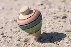 Spinning top. Colorful spinning top toy rotating on a axis Stock Images