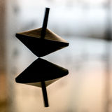 Spinning top in action on a mirror surface Stock Photos