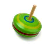 Spinning top toy. Old wooden spinning top toy isolated on white Royalty Free Stock Images