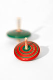 Spinning Top toy. Spinning top red and green Royalty Free Stock Photo