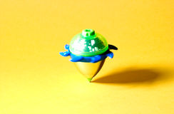 Spinning Top. On yellow background Stock Images