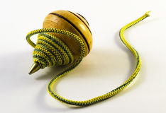 Spinning top. With a yellow rope green Stock Photos