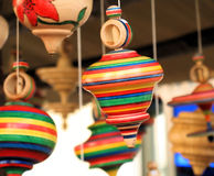 Spinning tops. Some wooden and hand made spinning tops stock photo