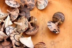 Spinning tops of wooden. Spinning tops decorative and colored of wooden Stock Image