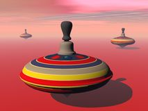 Spinning tops - 3D render Stock Photography