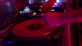Spinning turntable dj hands in nightclub. Stock footage stock video footage