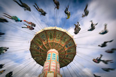 Spinning vintage swing ride. At a state fair stock images