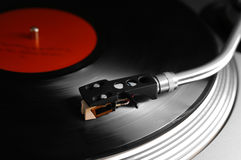 Spinning vinyl. Spinning in motion, the element/needle and grooves in front are in focus Royalty Free Stock Images