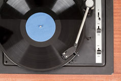 Spinning vinyl record. Motion blur image.  Vintage toned. Royalty Free Stock Photography