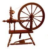 Spinning Wheel. Slightly chipped, elderly spinning wheel, still in regular use Stock Image