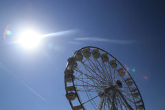 Spinning wheel. A spinning wheel under the sun, with clear sky Stock Photo