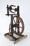 Spinning wheel. Old textile spinning wheel isolated Royalty Free Stock Photo