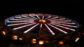Spinning wheel in amusement park stock video