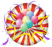 A spinning wheel with balloons at the center Royalty Free Stock Images
