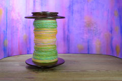 This is a spinning wheel bobbin filled with hand spun yarn Royalty Free Stock Images