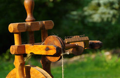 Spinning wheel. Detail spinning wheel on the green grass stock photo