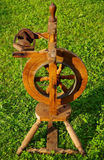 A spinning wheel. On green grass royalty free stock photography