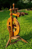 A spinning wheel. Spinning wheel on green grass royalty free stock photography