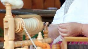 Spinning wheel. On a spinning wheel is spun wool stock video
