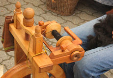 Spinning wheel in the street. Weaving of wool with spinning wheel in the street Royalty Free Stock Photography