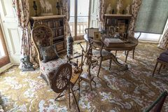 Spinning Wheel and table in Osborne House Isle of Wight. Osborne House is a former royal residence in East Cowes, Isle of Wight, United Kingdom. The house was Royalty Free Stock Photography