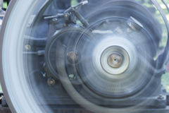 Spinning Wheels. Wheels spinning on an antique steam-powered machine - motion blur Stock Image