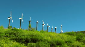 Spinning Wind Turbines in a Row stock video footage