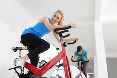 Spinning; women cycling at the gym Royalty Free Stock Images