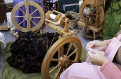 Free Spinning Wool On Spinning Wheel Stock Images - 162154304