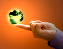 Spinning the World. Business concepts world at your fingertips stock photo