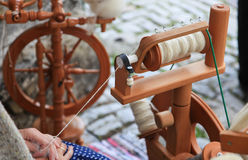 Spinning yarn from wool Royalty Free Stock Image