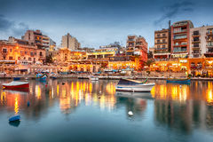Spinola Bay with bioats in front of famous touristic restaurants. MALTA - JANUARY 19 2015: Spinola Bay with boats in front of famous touristic restaurants at St Royalty Free Stock Photo