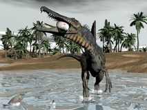 Spinosaurus dinosaur eating fish - 3D render Royalty Free Stock Images