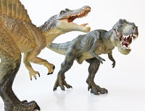 A Spinosaurus Faces Off with A Tyrannosaurus Rex. A Spinosaurus Dinosaur in a Face Off with a Tyrannosaurus Rex stock images