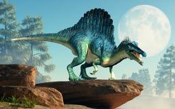 Spinosaurus på en klippa fotografering för bildbyråer