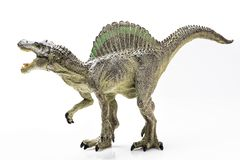 Spinosaurus plastic figurine. On white background royalty free stock photos