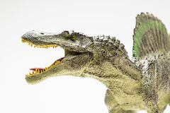Spinosaurus plastic figurine. On white background royalty free stock image