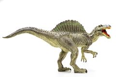 Spinosaurus plastic figurine. On white background royalty free stock photo