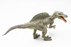 Spinosaurus plastic figurine. On white background royalty free stock images