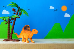 Spinosaurus toy model on wild models background. Closeup Stock Images